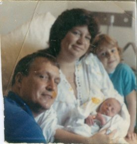 Dad, Mom, me and my little sister Magan.